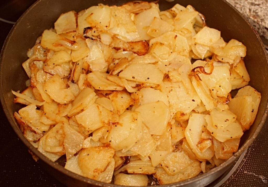 pan fried potatoes and onions on stove
