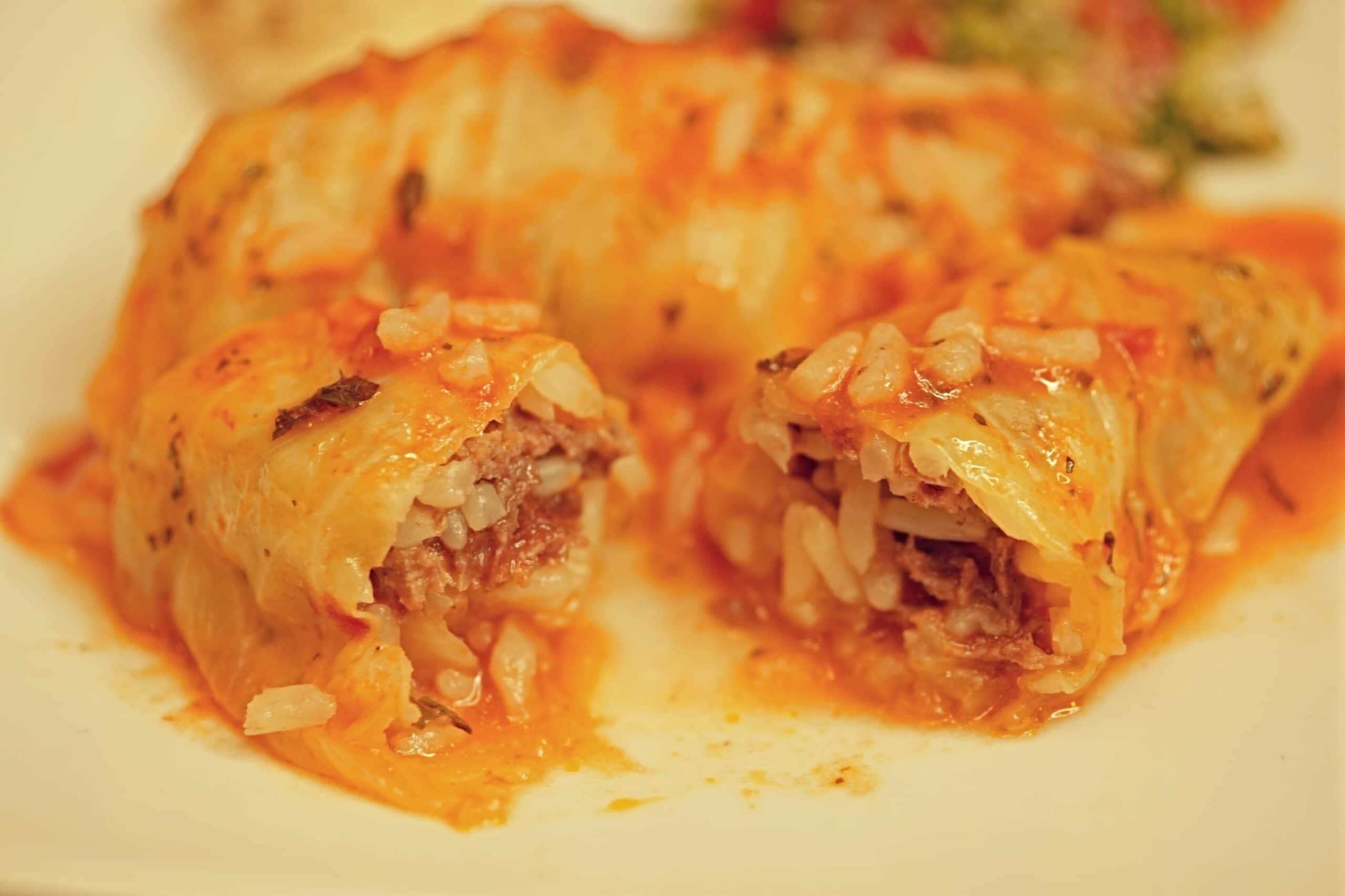 Stuffed with a mixture of white rice, ground beef and Mediterranean spices, these cabbage rolls are cooked in tomato sauce and spiced with lemon, mint and garlic