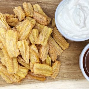 Homemade churros recipe with homemade whipped cream and chocolate sauce for dipping
