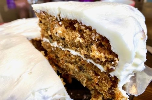 This is by far the BEST recipe for homemade carrot cake from scratch! The carrot cake recipe with walnuts is perfectly moist and frosted with amazing cream cheese frosting from scratch also. This is the perfect spring dessert, perfect for any party or Easter brunch. I use walnuts in it but feel free to add raisins or to make it as cupakes! -APinchOfAdventure