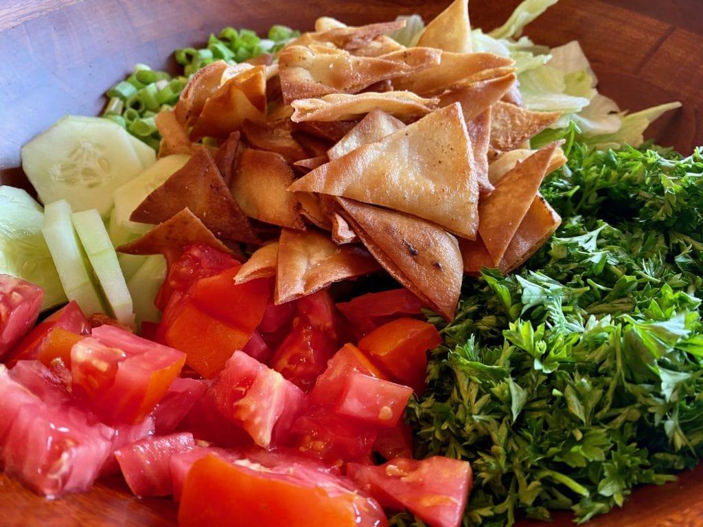 Mediterranean chopped salad with pita chips and homemade Mediterranean salad dressing