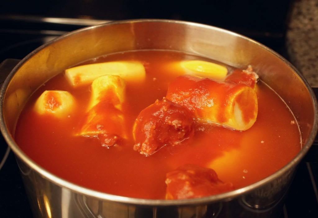 Lebanese stuffed squash in tomato sauce in a large pot