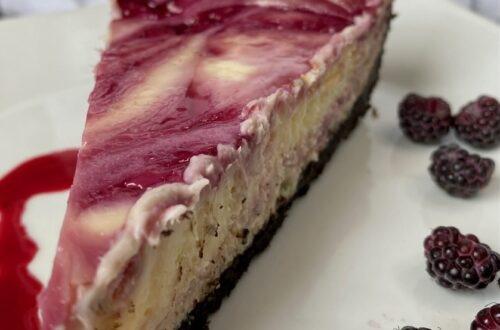 White chocolate raspberry cheesecake with black raspberries