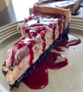 White chocolate raspberry cheesecake with homemade raspberry topping