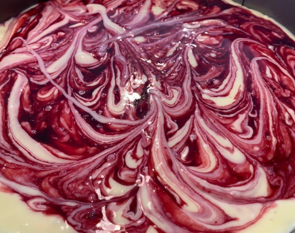 white chocolate raspberry cheesecake, raspberry swirl cheesecake